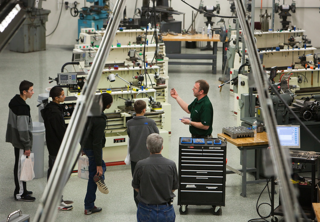 students observe manufacturing plant